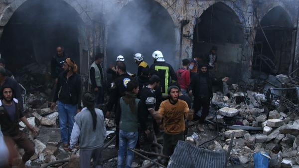 Searchers look for survivors after an airstrike on the town of Harim in northwestern Idlib province in Syria.