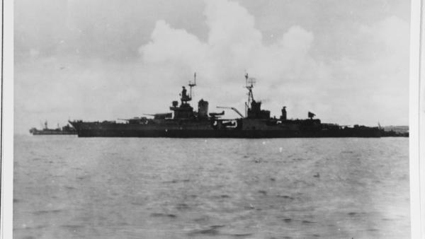 USS Indianapolis preparing to leave Tinian after delivering atomic bomb components, circa 26 July 1945.