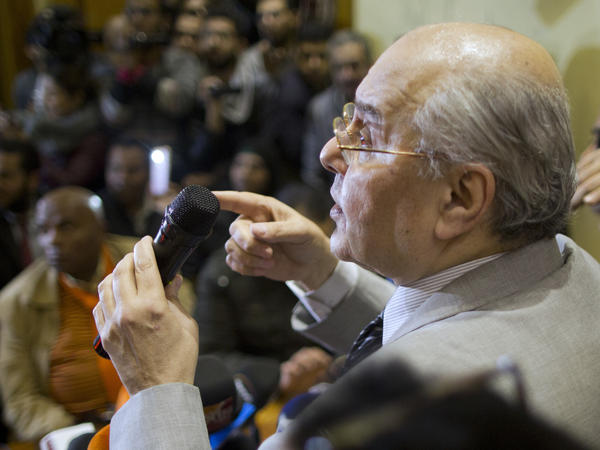 Moussa Mustafa Moussa talks during a press conference at his Cairo office in January.