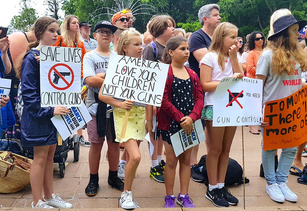 School children hold placards during a rally to show solidarity with U.S. students in their attempt to end gun violence in America, in central Sydney, Australia.
