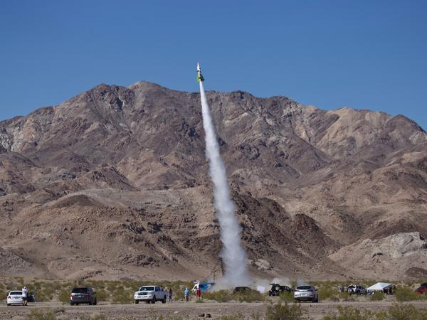 """""""Mad"""" Mike Hughes' homemade rocket takes to the skies above Amboy, Calif., on Saturday. The self-taught rocket scientist who believes the Earth is flat propelled himself about 1,875 feet into the air before a hard landing in the Mojave Desert left him injured."""