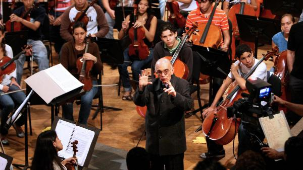 "Venezuelan conductor and composer José Abreu delivers a speech to the young musicians of his orchestra in Caracas, Venezuela in January, 2009. Abreu was the founder of ""El Sistema,"" an educational framework intended to extend musical instruction to children, regardless of their background."