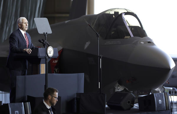 Vice President Pence addresses U.S. military personnel in front of an Air Force F-35 fighter at U.S. Yokota Air Base, on the outskirts of Tokyo, on Feb. 8. The military will be buying an additional 90 F-35s this year; the aircraft is its most modern — and most expensive — fighter jet.
