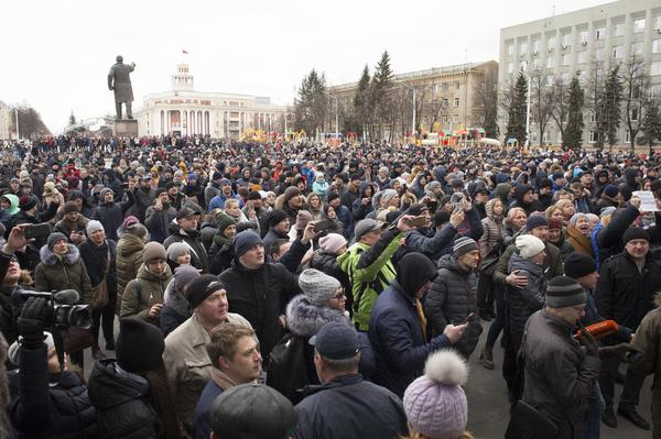 "Crowds gather to pay last respects to the victims of the Winter Cherry mall fire in Kemerovo, Russia. President Vladimir Putin, who made a surprise visit to the city, blamed the deaths on ""criminal negligence, sloppiness."""