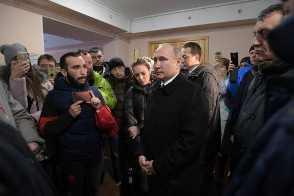 Russian President Vladimir Putin meets with local residents and relatives of people missing in a fire at a shopping center.