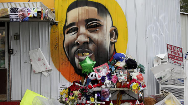 A makeshift memorial for Alton Sterling, seen outside the Triple S Food Mart where he died, in Baton Rouge, La., in July 2016.