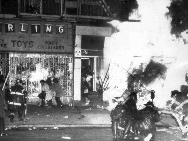 Firemen battle a blaze on 125th Street in Harlem on April 4, 1968, after a furniture store and other buildings were set on fire after it was learned that civil rights leader the Rev. Martin Luther King Jr., had been assassinated in Memphis.