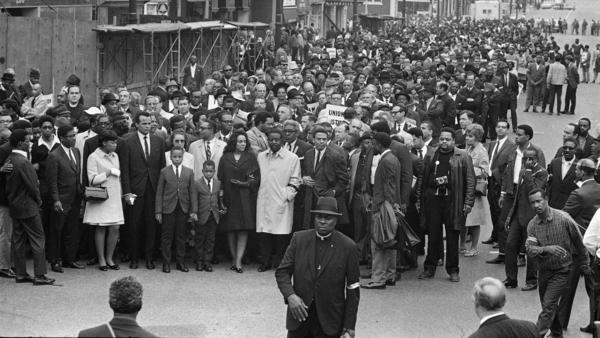 Coretta Scott King, center, accompanied by the Rev. Ralph Abernathy, her children, and singer Harry Belafonte, leads a march in Memphis to honor her husband who was assassinated four days earlier.