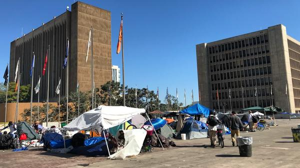 Orange County officials rescinded plans to establish three temporary shelters on county land near the ocean. Two blocks away from the hearing in Santa Ana, a sprawling homeless encampment remains in front of the courthouse.