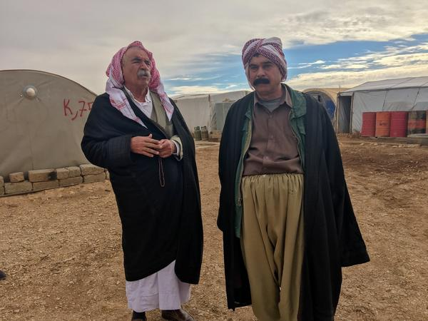Saeed Ahmed Khalaf, left, and his family live in a tent on Mount Sinjar. He believes the U.S. would either help protect the Yazidis in Sinjar or help the group emigrate to a safe place.