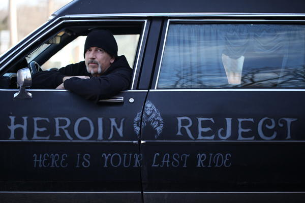 "Dwayne Wood behind the wheel of the ""Heroin Hearse."""