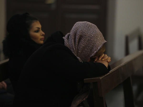 An Iranian woman prays at St. Joseph's Cathedral in Tehran, Iran, a country where Christians and other religious groups have faced persecution.