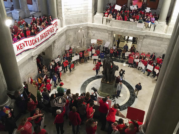 "Hundreds of Kentucky teachers protest outside Gov. Matt Bevin's office Friday in Frankfort, Ky. They crowded into the building, shouting ""Vote them out,"" less than a day after lawmakers quickly passed a surprise overhaul of state employee retirement benefits."