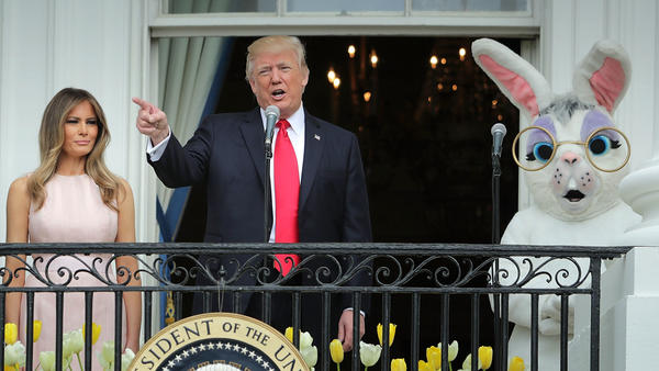 President Trump delivers remarks from the Truman Balcony with first lady Melania Trump and someone dressed as a bunny during last year's Easter Egg Roll on the South Lawn.