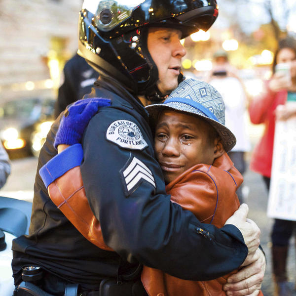 In 2014, Portland police Sgt. Bret Barnum and Devonte Hart, 12, hug at a rally in Portland, Ore., where people had gathered in support of the protests in Ferguson, Mo.