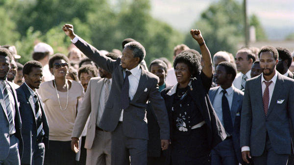 Nelson Mandela leaves prison hand in hand with his then-wife, Winnie, upon his release in 1990.