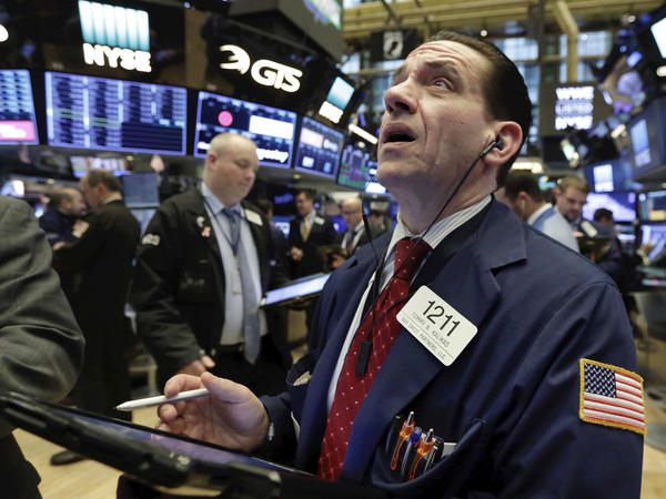 Trader Tommy Kalikas works Monday on the floor of the New York Stock Exchange. Major stock indexes fell sharply, led by tech stocks, amid fears of an intensifying U.S. trade war with China.