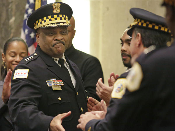 Chicago Police Superintendent Eddie Johnson (left) at a City Council meeting in 2016. Johnson says new hires and data-driven policing are helping to bring crime numbers down.