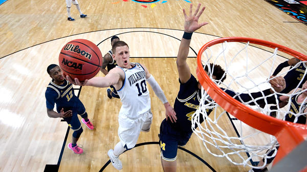 Donte DiVincenzo of the Villanova Wildcats drives to the basket Monday night against Isaiah Livers of the Michigan Wolverines in the first half during the 2018 NCAA Men's Final Four National Championship game at the Alamodome in San Antonio. DiVincenzo came off the bench to score 18 points in the half and 31 in the game.