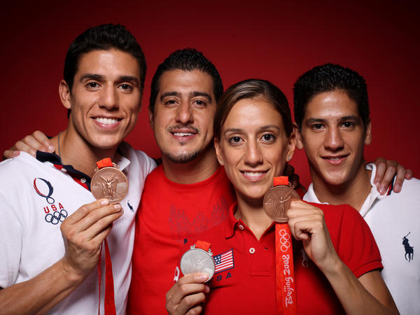 "Taekwondo athletes Steven (from left), Jean, Diana and Mark Lopez of the United States pose in the NBC <em>Today</em> show studio at the Beijing 2008 Olympic Games. The <em>Los Angeles Times</em> named them the ""first family of taekwondo."""