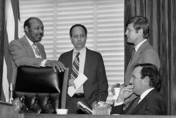 House Assassinations Committee chief counsel G. Robert Blakey talks to committee chairman Louis Stokes, D-Ohio, in Washington on Dec. 22, 1978.