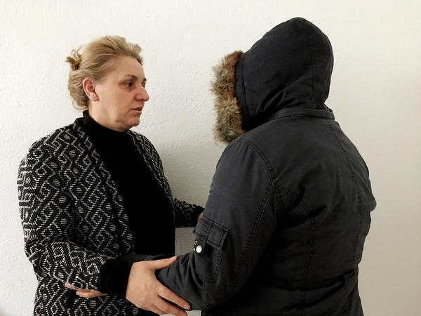 "Khadire Tahiraj (left) runs the Center for Promotion of Women's Rights in the Drenas municipality in central Kosovo. The center cares for scores of wartime rape survivors, including Sana (right). Sana is not her real name; she chose it for herself because she doesn't want her family to know she was raped. ""We are like orphans,"" Sana says. ""And Kadire is like our mother."""