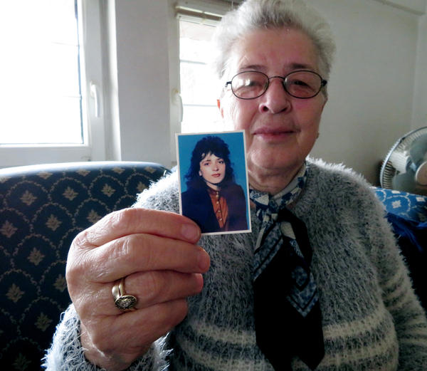 "Sanije Salihu, 70, of Gjakova, eastern Kosovo, holds up a photo of her daughter, Vjollca, at age 20. Vjollca was violently raped and beaten during the 1998-1999 war with Serbia and was left paralyzed. She died in 2006. ""If she had died during the war, [Kosovo] would have mourned her,"" Salihu says. ""My heart aches that she wasted away like she was nothing."""