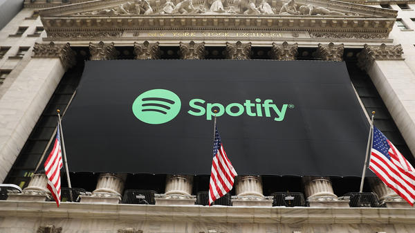 The Spotify banner hangs from the New York Stock Exchange on the morning that the music streaming service begins trading shares, on April 3, 2018 in New York City. The question now is: Where to?