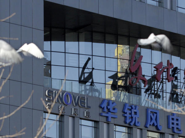 Pigeons fly past the company logo of Sinovel Wind Co., Ltd. outside its head office in Beijing, in 2011. In January 2018, Sinovel was convicted in the U.S. of stealing trade secrets from American Superconductor.