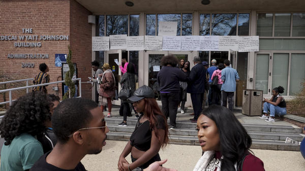 People gather outside the Mordecai Wyatt Johnson Building in Washington D.C., during a sit-in at Howard University last week. By Thursday the students were entering their second week of protest and say they won't move until they are satisfied.