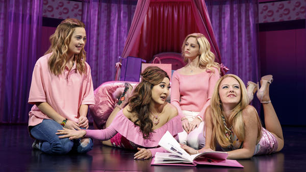 Cady (Erika Henningsen, left) wears pink along with fellow Plastics Gretchen (Ashley Park), Regina (Taylor Louderman) and Karen (Kate Rockwell) in the musical <em>Mean Girls</em>.