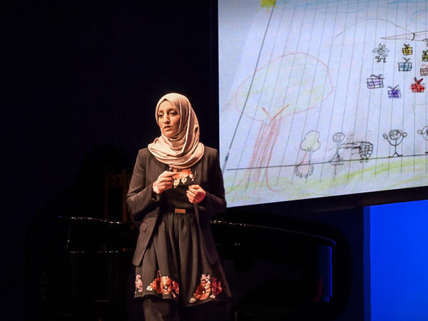 Aala El-Khani speaks on the TED stage.