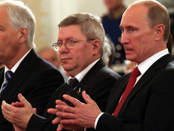 Russian politician Alexander Torshin, with Russian leader Vladimir Putin, is one of a number of powerful Russians sanctioned by the United States on Friday.