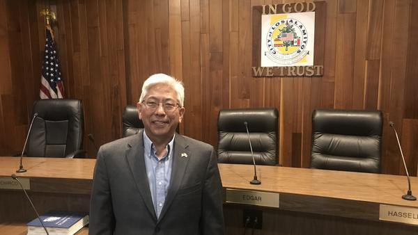 Los Alamitos Mayor Pro Tem Warren Kusumoto argues his small city is caught in the middle of a legal fight between the Trump administration and the state of California.
