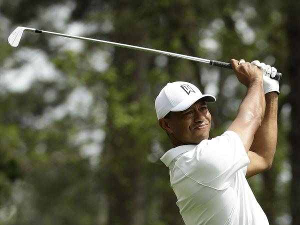 Tiger Woods hits on the fourth hole during the second round at the Masters golf tournament Friday.
