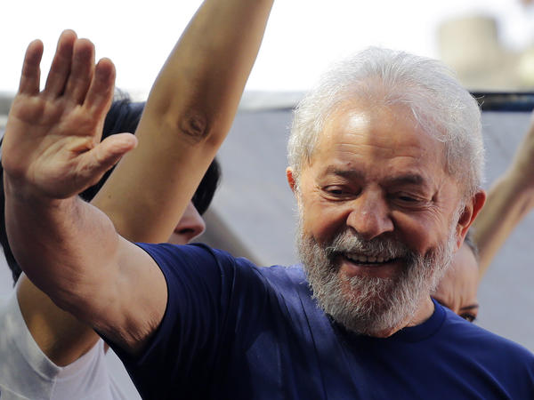 Brazil's former President Luiz Inacio Lula da Silva gestures to supporters in front of the metal workers union headquarters in Sao Bernardo do Campo, Brazil, Saturday.