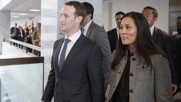 Facebook CEO Mark Zuckerberg and his assistant, Andrea Besmehn, arrive on Capitol Hill on Monday. Zuckerberg has accepted the blame for security lapses at the world's largest social network as he girds for appearances this week before angry lawmakers.