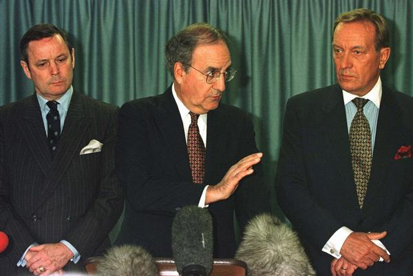 Former Sen. George Mitchell (center) speaking during a press conference at the restart of the Northern Ireland Peace Talks, Tuesday, June 3, 1997, in Stormont Castle Buildings, Belfast, Northern Ireland. With Mitchell are joint co-chairmen of the peace talks, former Finnish Prime Minister Hari Holkeri, right, and Canadian General John de Chastelain. (Paul McErlane/AP)