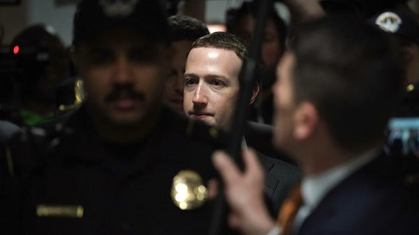 Facebook CEO Mark Zuckerberg is escorted by police on his way to a meeting Monday with U.S. Sen. Dianne Feinstein, D-Calif., ranking member of the Senate Judiciary Committee.