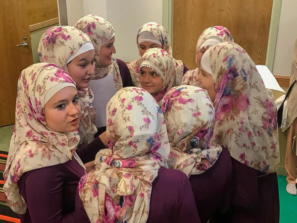 A girls' choir at the Bosnian Islamic Cultural Center in Chicago gather after performing for the congregation.