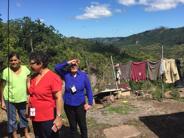 In front of Johanna Garcia Mercado's home in Castañer, the hillside collapsed during the hurricane. Since then, Mercado (left) has had panic attacks and finds herself crying uncontrollably. She has been seeing a psychologist at the local hospital and a social worker makes frequent visits.