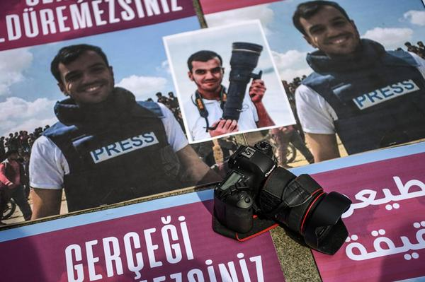 Placards from a protest in Istanbul against the killing of Palestinian journalist Yaser Murtaja.