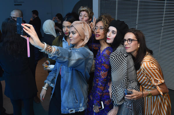 Amani Al-Khatahtbeh (center, holding camera), founder of MuslimGirl, and Elaine Welteroth (center, in glasses), former editor-in-chief of <em>Teen Vogue</em>, join a group selfie at National Geographic's premiere screening of <em>America Inside out with Katie Couric</em> in April in New York City.