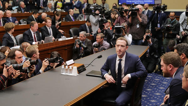 Facebook co-founder and CEO Mark Zuckerberg prepares to testify before the House Energy and Commerce Committee in the Rayburn House Office Building on Capitol Hill on Wednesday. This is the second day of testimony before Congress by Zuckerberg, 33.