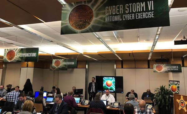 Participants in Homeland Security's cyberattack simulation work in a conference room at the Secret Service headquarters in Washington, D.C., on Tuesday.