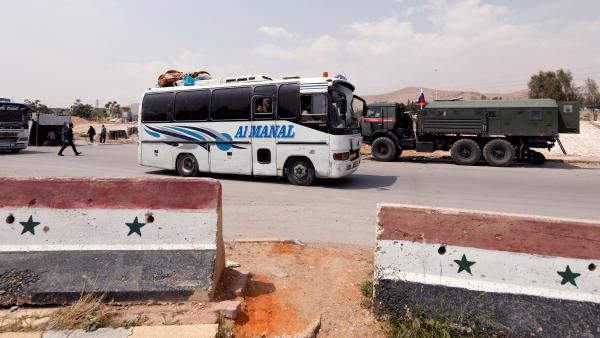 A bus carries rebels and their families who have fled Douma, Syria, the site of an alleged chemical attack over the weekend that killed dozens.