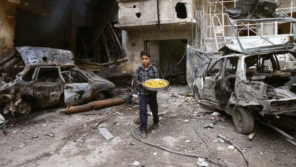 A boy walks through war-torn Douma, Eastern Ghouta, outside of Damascus, Syria, last month. The onetime rebel stronghold is reportedly now under government control.