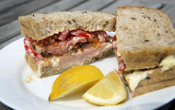 Chef Kathy Gunst's tuna sandwich with tomatoes and lemon-orange mayonnaise. (Robin Lubbock/WBUR)