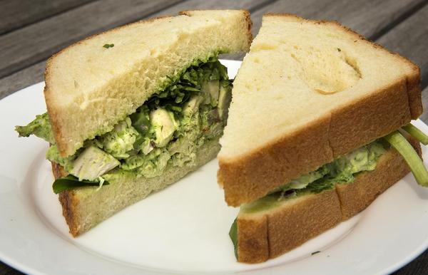 Chef Kathy Gunst's chicken salad sandwich with watercress mayonnaise. (Robin Lubbock/WBUR)