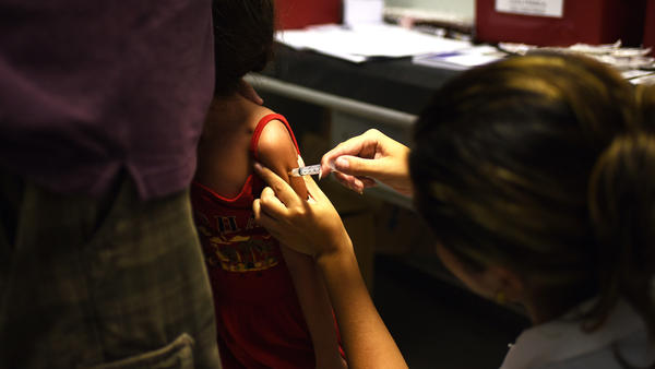 A girl is vaccinated against yellow fever in Rio de Janeiro.